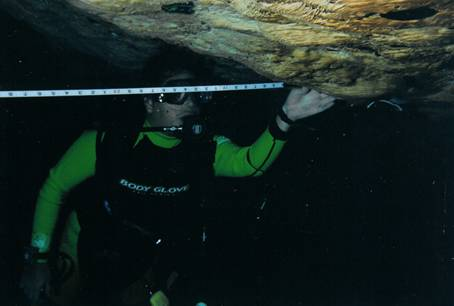 Photo 11. Alejandro Perez mapping a cenote.